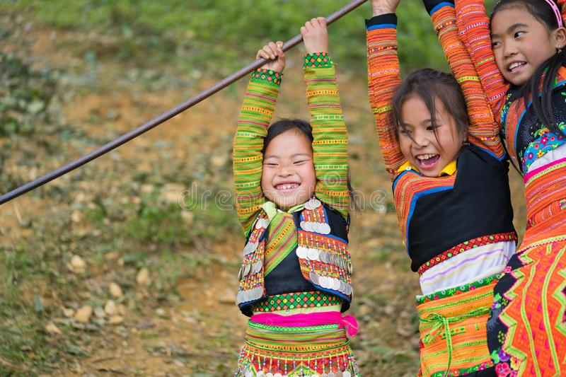 Son La, Vietnam - Jan 13, 2016: Ethnic H`mong children in traditional clothes playing on playground during H`mong New Year holid. Ay in Ta Xua village, Bac Yen stock photography