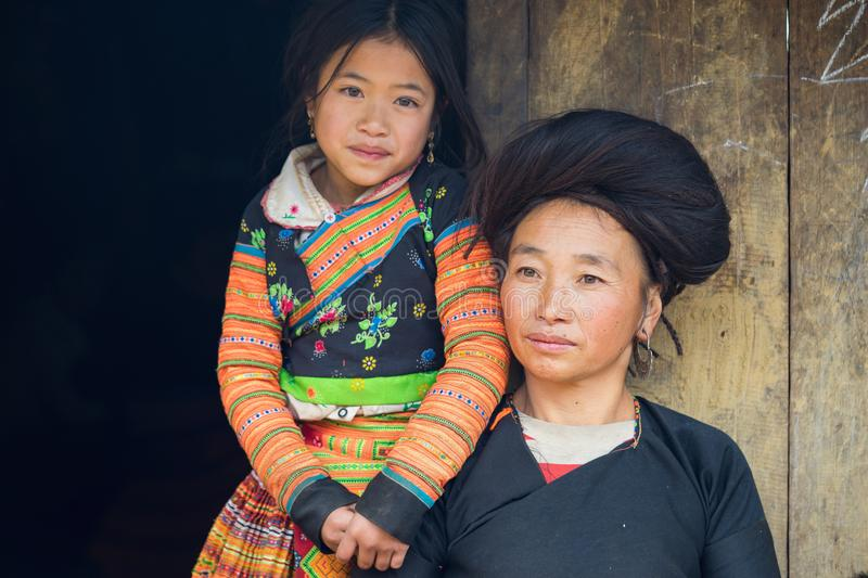 Son La, Vietnam - Jan 13, 2016: Portrait of H`mong mother and her daughter in front of their house in Ta Xua ethnic village, Bac stock image