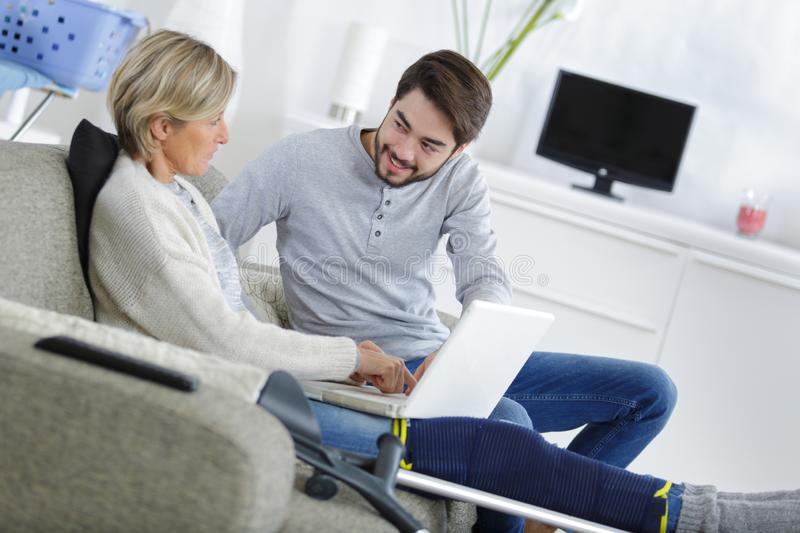 Son looking after injured mother stock photos