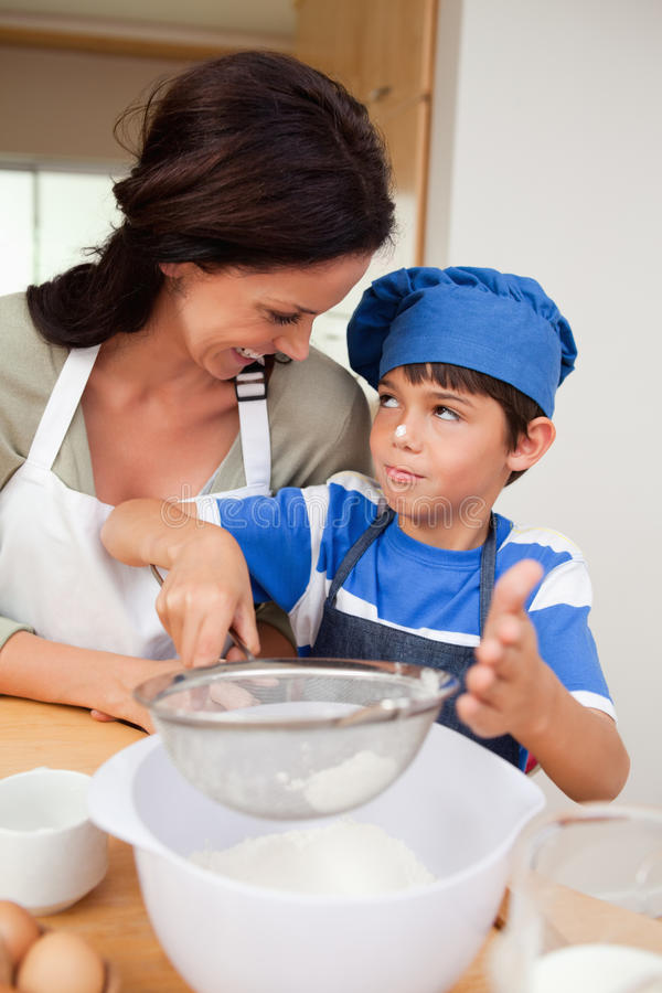 Son and mother baking royalty free stock photography