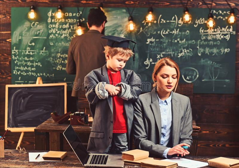 Son with mother and father have lesson. Genius boy teach woman and man at chalkboard. Little child and family in. Son with mother and father have lesson. Genius stock image