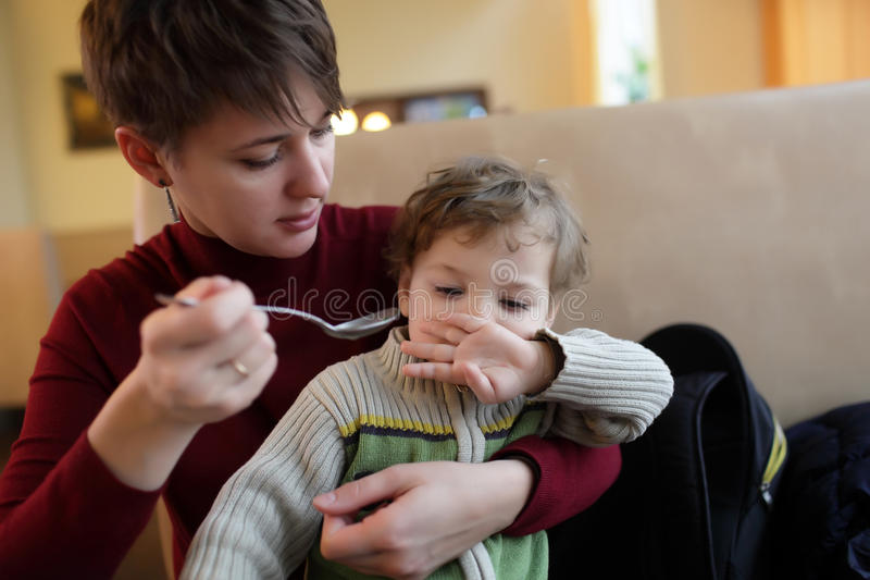 Son refuses to eat. In the cafe royalty free stock photography