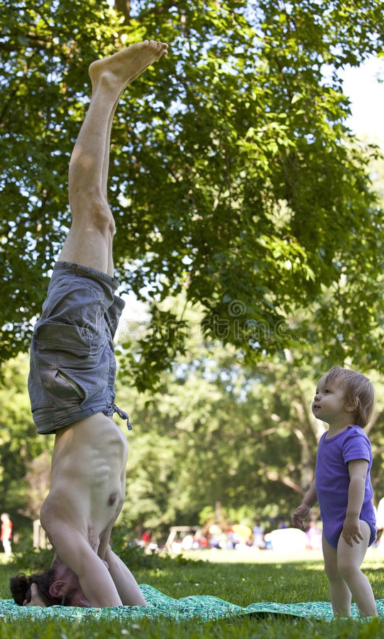 Download Son's idol stock photo. Image of headstand, family, activity - 15116804