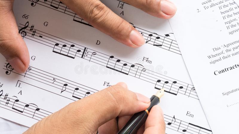 Song composer working on music note paper stock photos