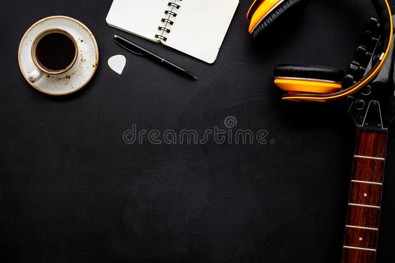 Song writer set with musician and DJ instruments black background top view space for text royalty free stock image