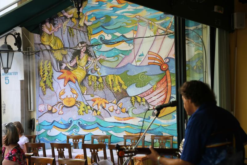 Songer på restaurangAten Grekland royaltyfri fotografi