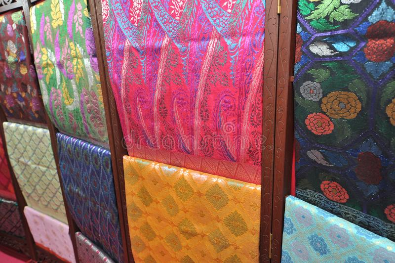 Songket textiles. Songket is a fabric that belongs to the brocade family of textiles of the Malay world today, Indonesia, Malaysia, Brunei, Singapore and royalty free stock images