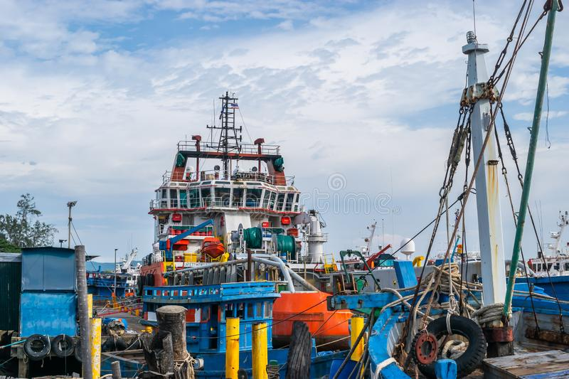 Songkhla, Thailand - August 6, 2017; View of industrial ships in the port of Songkhla Lake near by Nang ngam road. Songkhla, Thailand - August 6, 2017; View of stock images