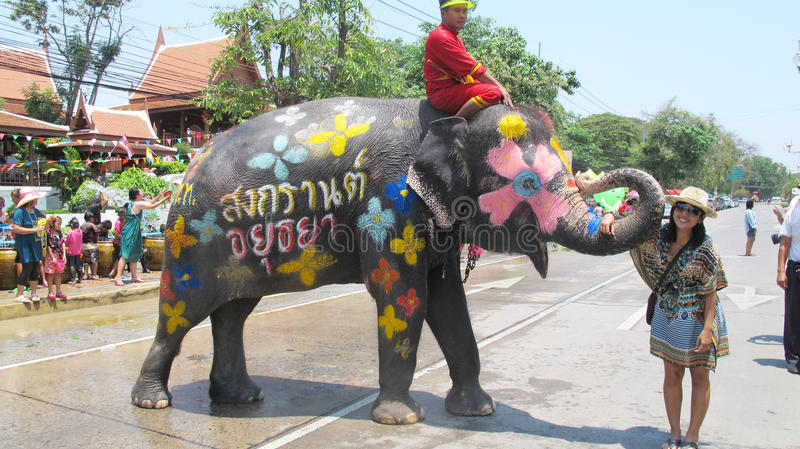 Songkran Festival is celebrated with elephants in Ayutthaya. The Songkran festival (Thai: สงกรานต์) is celebrated in royalty free stock image