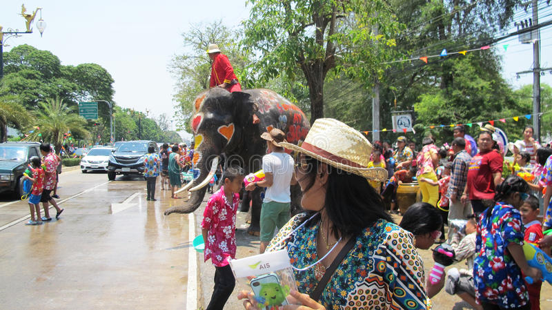 Songkran Festival is celebrated with elephants in Ayutthaya. The Songkran festival (Thai: สงกรานต์) is celebrated in royalty free stock photo