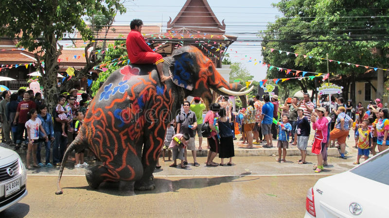 Songkran Festival is celebrated with elephants in Ayutthaya. The Songkran festival (Thai: สงกรานต์) is celebrated in stock photo
