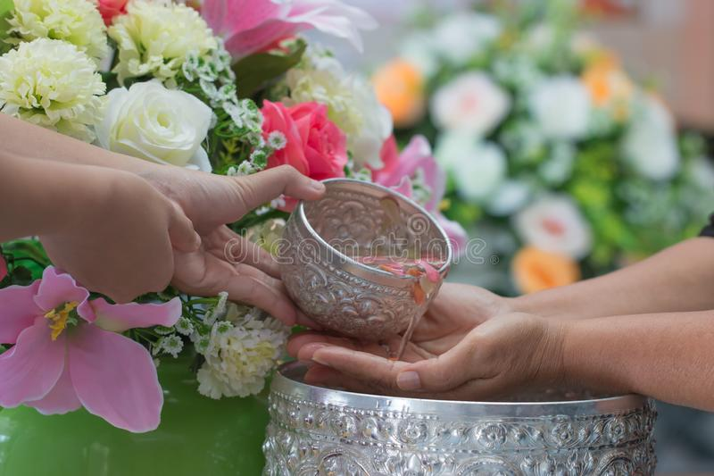Songkran Thai festival concept : Thai people celebrate Songkran in new year water festival by giving garlands to elder seniors and stock photo