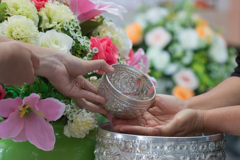 Songkran Thai festival concept : Thai people celebrate Songkran in new year water festival by giving garlands to elder seniors and stock photography