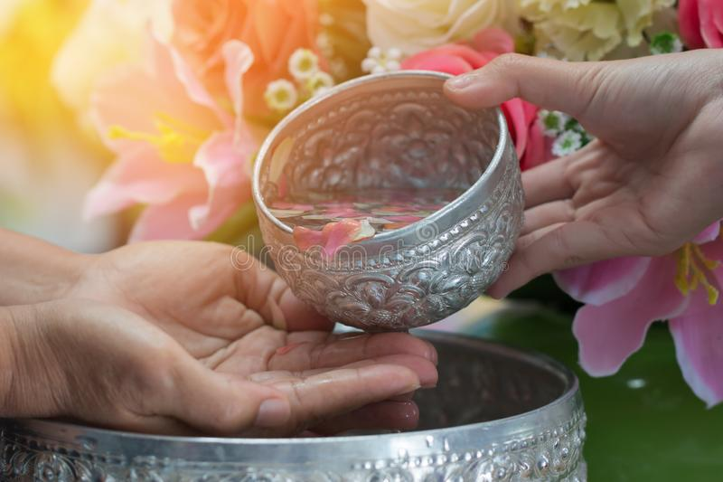 Songkran Thai festival concept : Thai people celebrate Songkran in new year water festival by giving garlands to elder seniors and. Asked for blessings to good royalty free stock photo