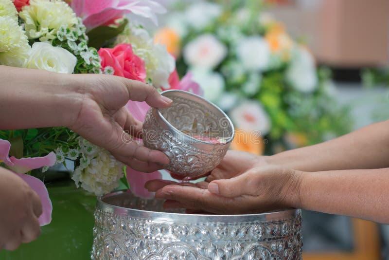 Songkran Thai festival concept : Thai people celebrate Songkran stock photos