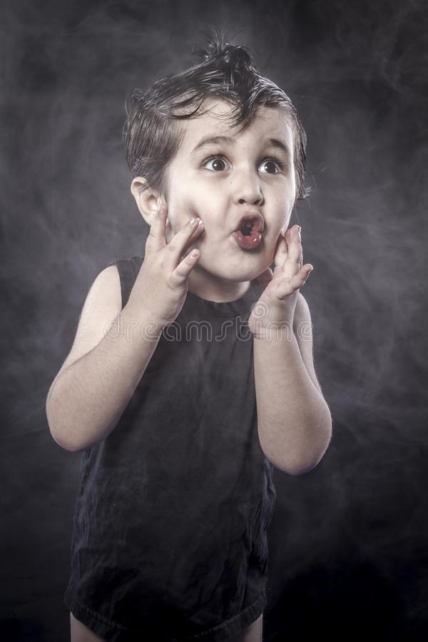 Songster, child rocker dress and funny expressions crested. Act, child rocker dress and funny expressions crested, expression royalty free stock images