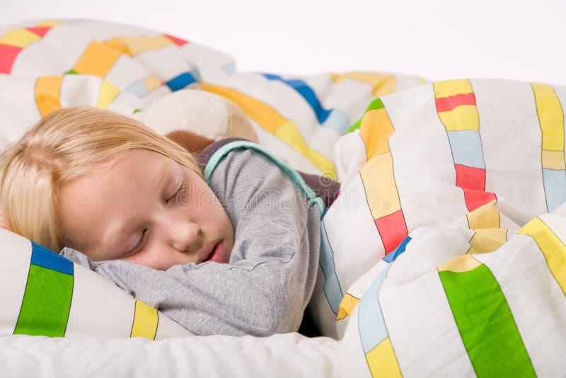 Sonhando a criança loura fotografia de stock royalty free