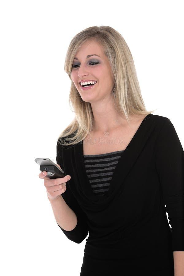 Sonia que mira el teléfono fotografía de archivo libre de regalías