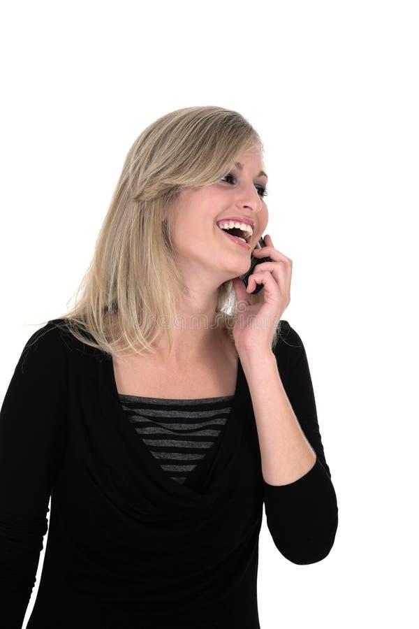 Sonia que ríe en su teléfono celular imagen de archivo