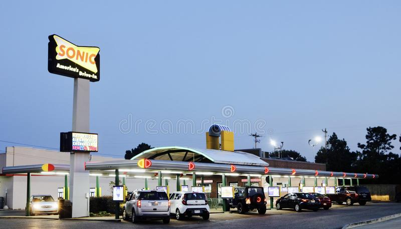 Sonic Drive In Restaurant at Night. Sonic Drive-In, more commonly known as Sonic, is an American drive-in fast-food restaurant chain based in Oklahoma City stock images