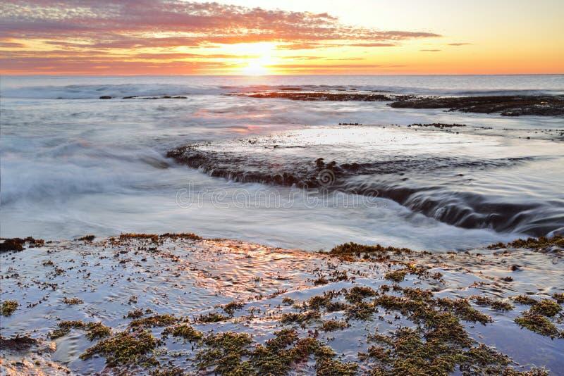 Sonnenaufgang-langes Riff Australien stockbild