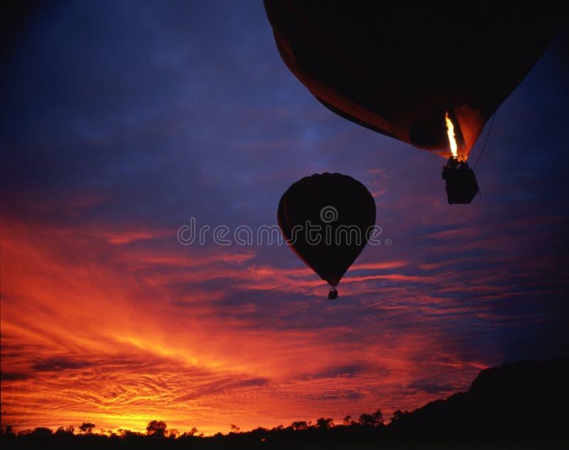 Sonnenaufgang mit Ballonen lizenzfreies stockbild