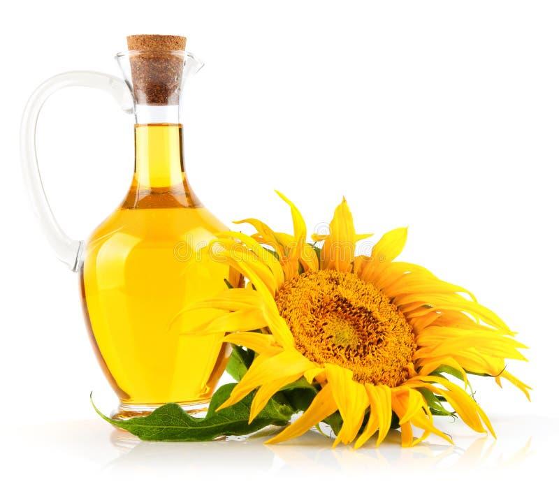 Sonnenblumenöl mit Blume lizenzfreie stockbilder