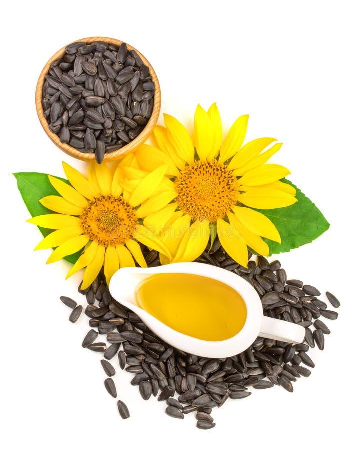 Sonnenblumenöl, Samen und Blume lokalisiert auf weißem Hintergrund Beschneidungspfad eingeschlossen lizenzfreie stockfotos