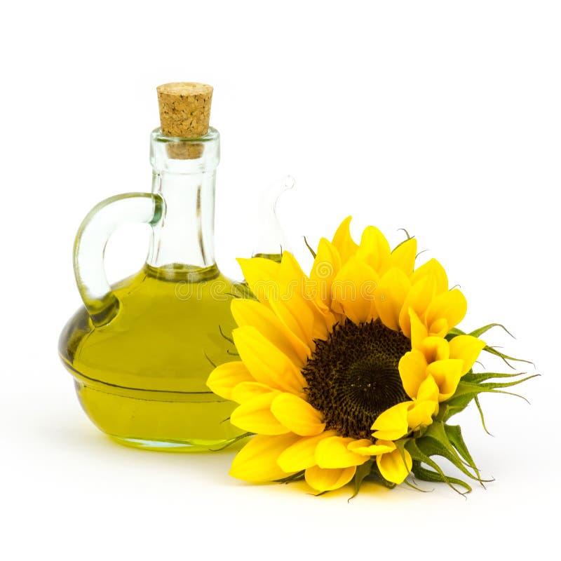 Sonnenblumenöl und Sonnenblumen lizenzfreies stockfoto