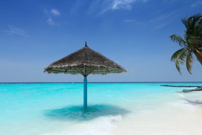 Sonnenschirm auf Strand
