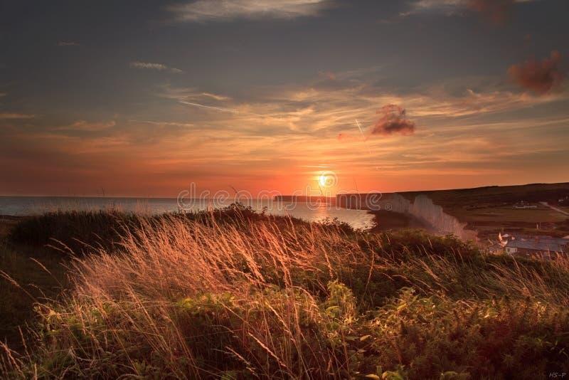 Sonnenuntergang über Birling Gap lizenzfreie stockfotos