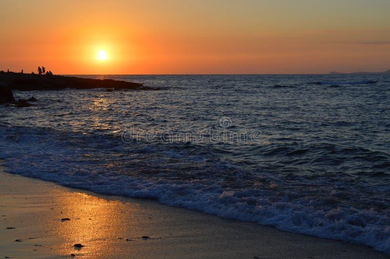 Sonnenuntergang auf Kato Gouves-Strand stockbilder