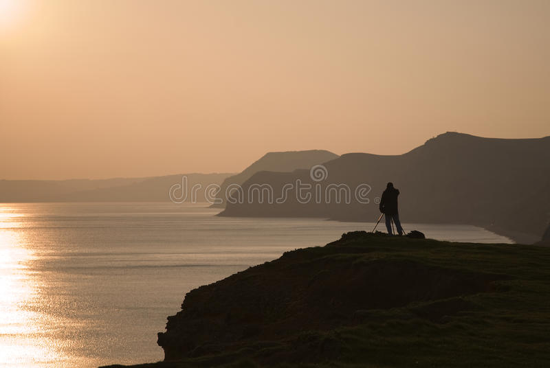 Sonnenuntergang-Fotograf lizenzfreie stockfotografie