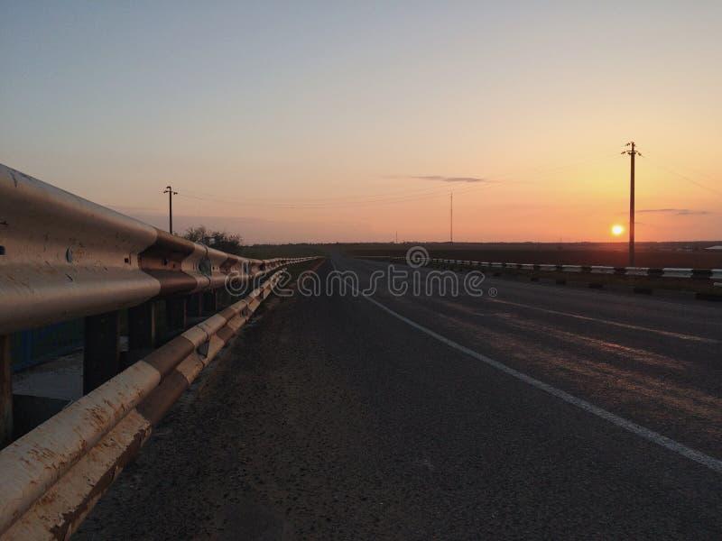Sonnenuntergang Straße lizenzfreie stockbilder