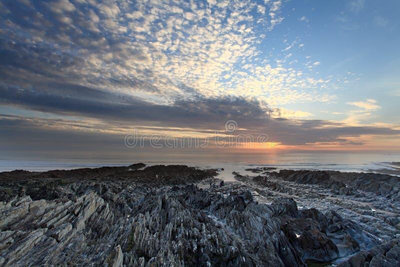 Sonnenuntergang Woolacombe   Nord-Devon-Küste lizenzfreie stockbilder