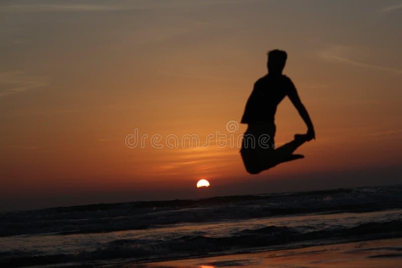 Sonnenuntergangschatten awesomeness schönes goa stockbild