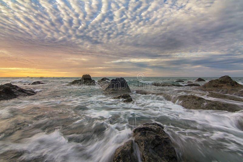 Sonnenuntergangwelle lizenzfreie stockfotografie