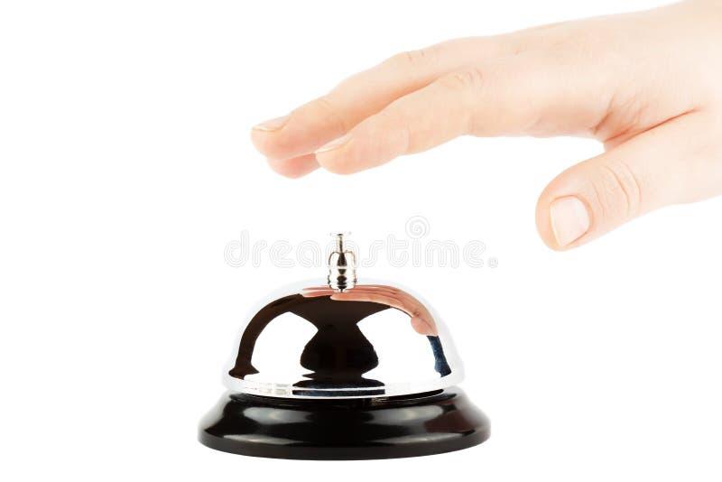 Sonnerie d'une Bell pour le service avec la main photo stock