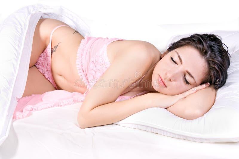 Sonno della donna in base fotografia stock libera da diritti