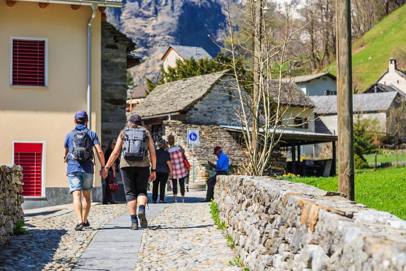 Walking on alley in Sonogno stock images