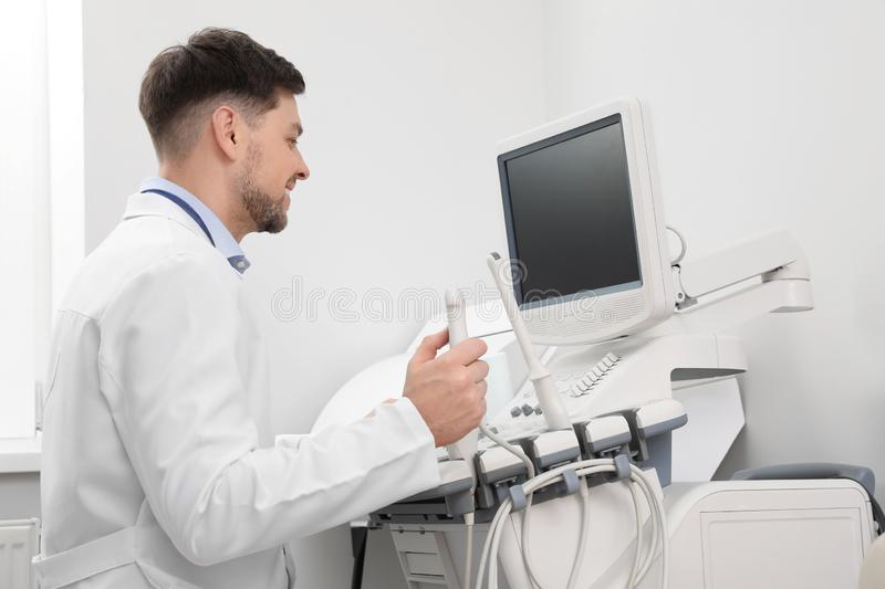 Sonographer operating modern ultrasound machine royalty free stock photo