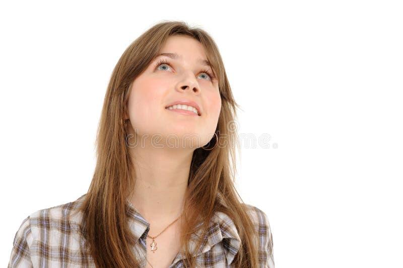 Sonriendo la muchacha que mira hacia arriba fotos de archivo