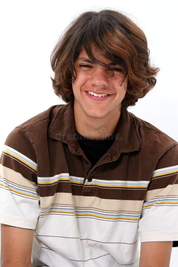 Sonrisa adolescente del muchacho fotos de archivo