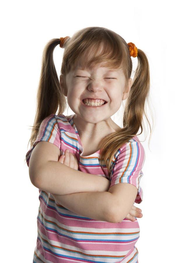 Sonrisa alegre de la niña. fotos de archivo