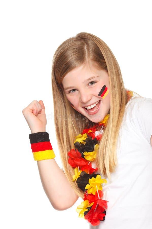 Sonrisa alemana del aficionado al fútbol fotografía de archivo libre de regalías