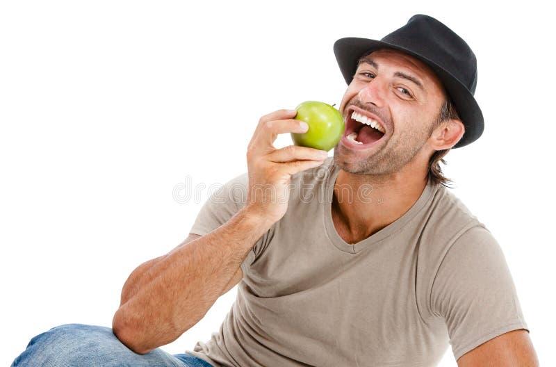 Sonrisa antropófaga una manzana verde imagenes de archivo