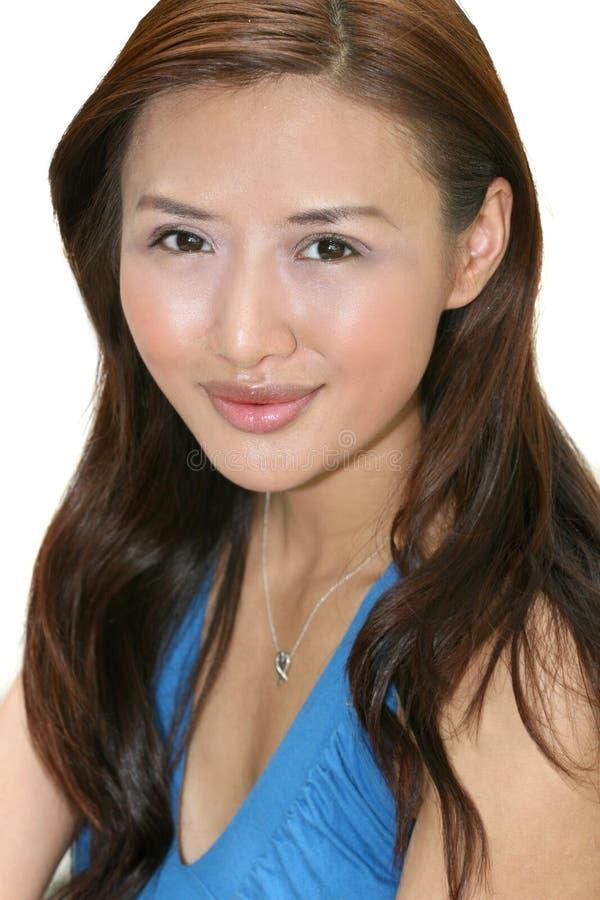 Sonrisa asiática joven de la mujer imagenes de archivo