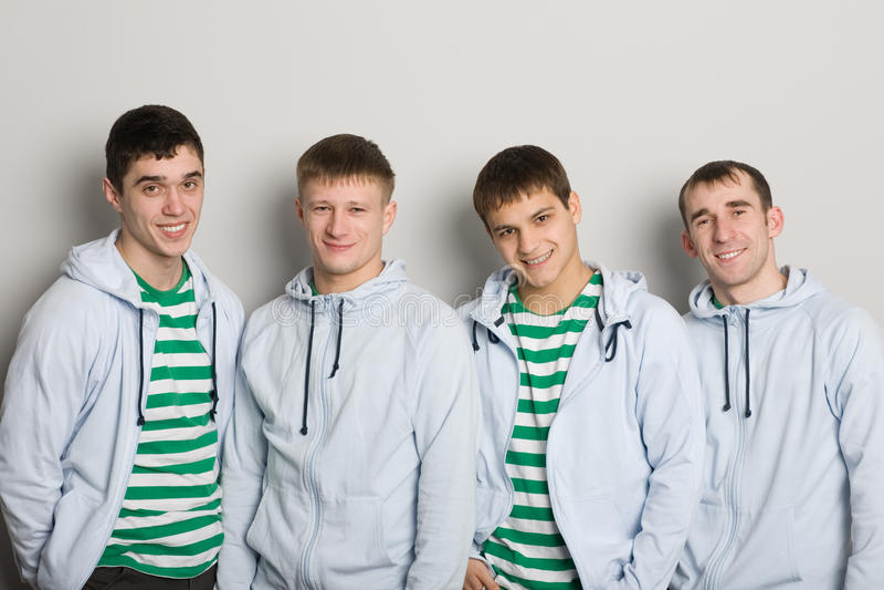 Sonrisa de cuatro amigos imagen de archivo