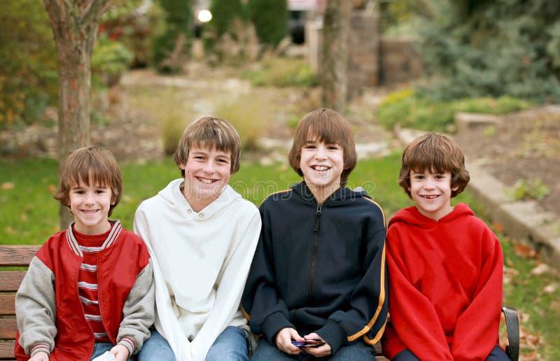 Sonrisa de cuatro muchachos imagen de archivo libre de regalías