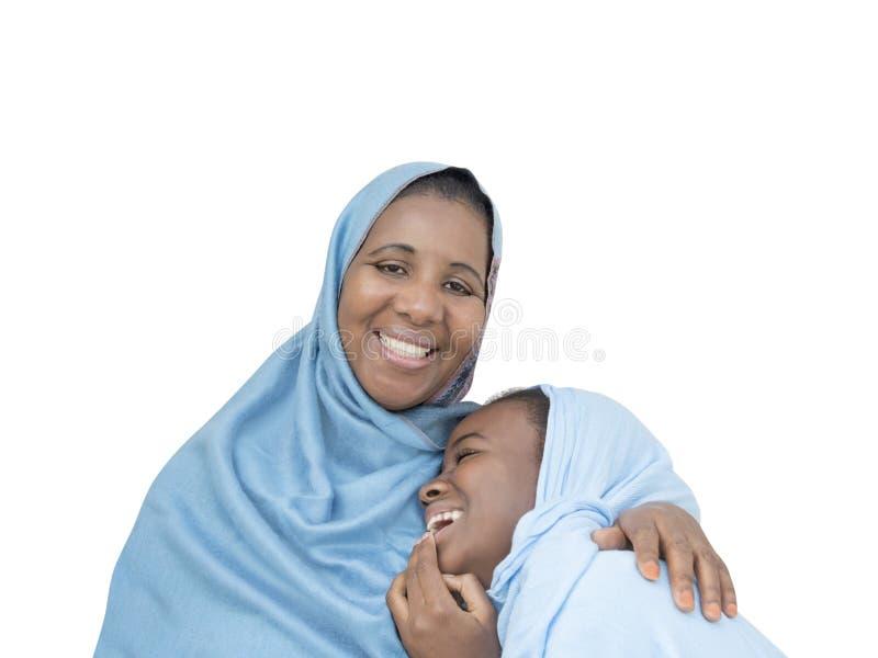 Sonrisa de la madre y de la hija, amor maternal y dulzura, aislados fotografía de archivo libre de regalías